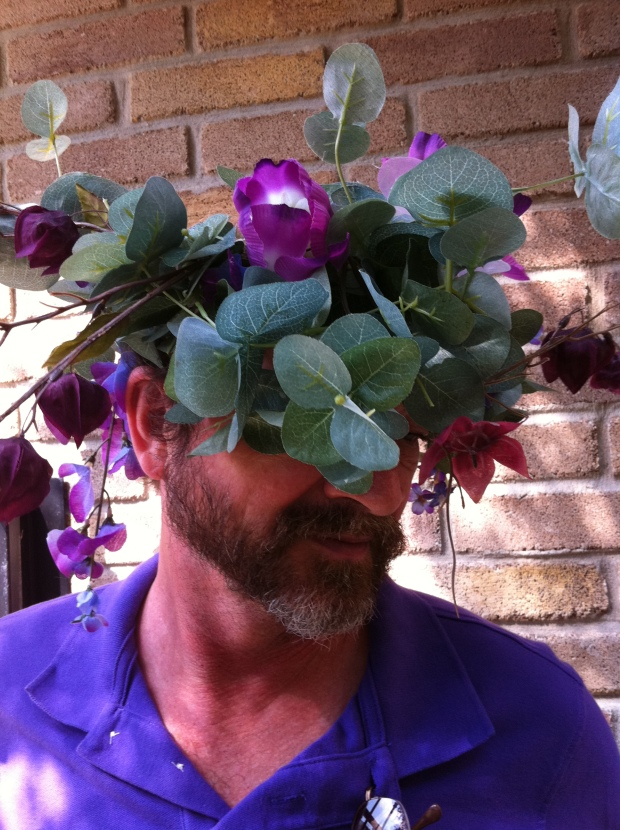 A man with flowers on his head by Mr. Bob Bevard